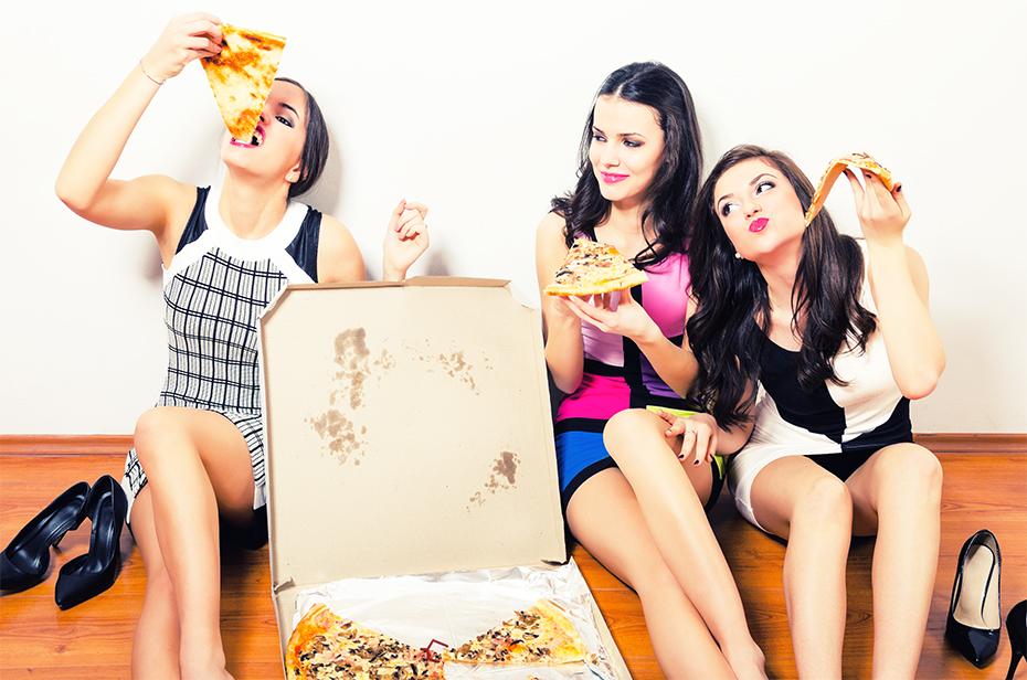 Girls Eating Pizza in dresses on floor