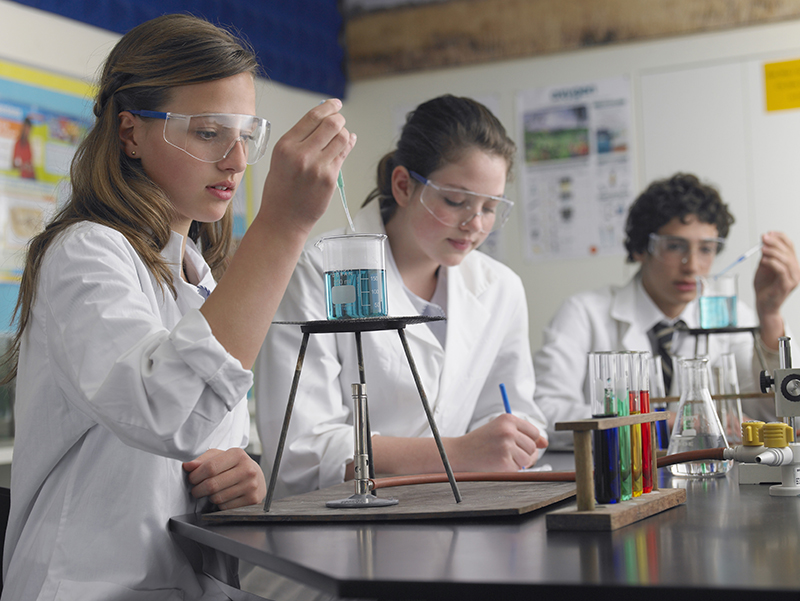 Kids doing an experiment in science class