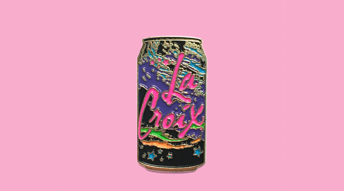 La Croix pin on a pink background