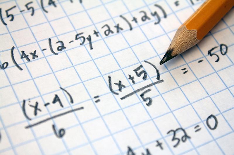 Math equations on grid paper