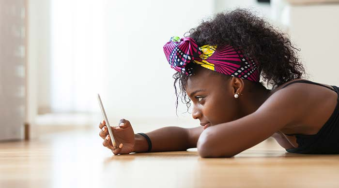 African American girl waiting for a text message from her ex