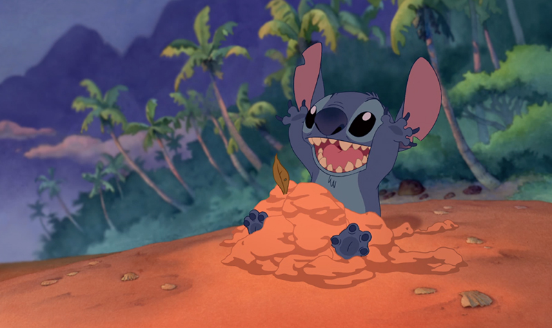 Stitch playing in sand at the beach in Disney's Lilo & Stitch