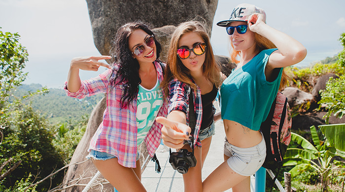 Group of girls posing for a picture while on a summer vacation
