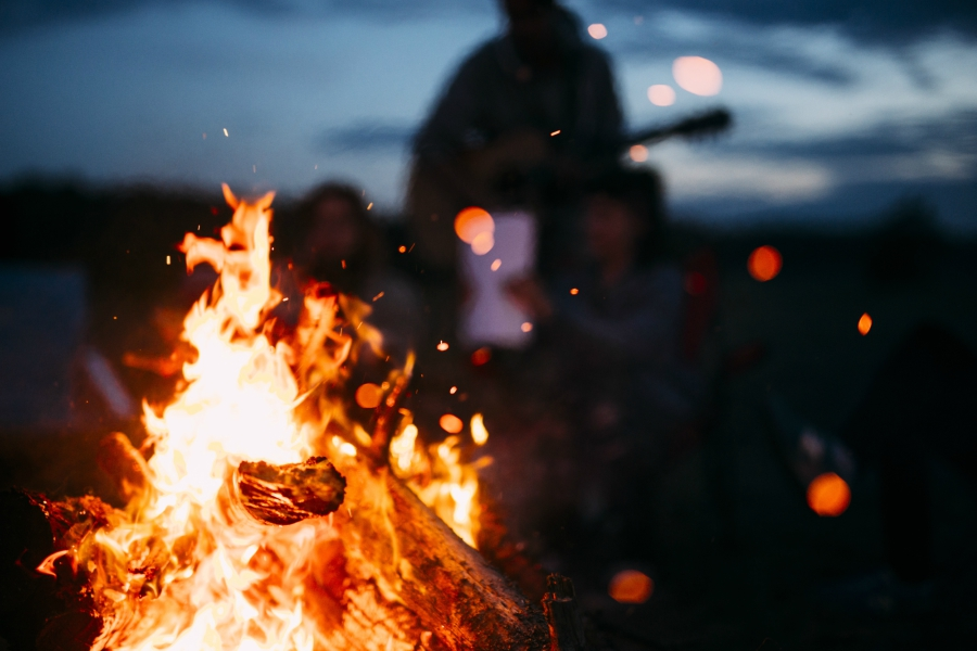 People around a campfire at night