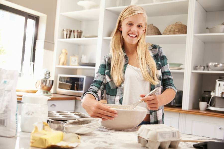 Teen girl cooking in the kitchen