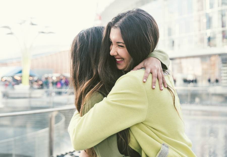 Two girl friends hugging