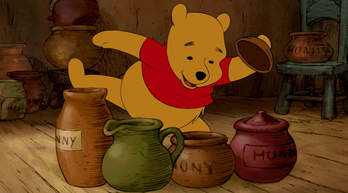 Winnie the Pooh looking through empty honey pots