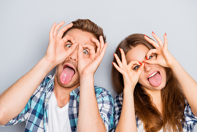 Couple making silly faces at the camera