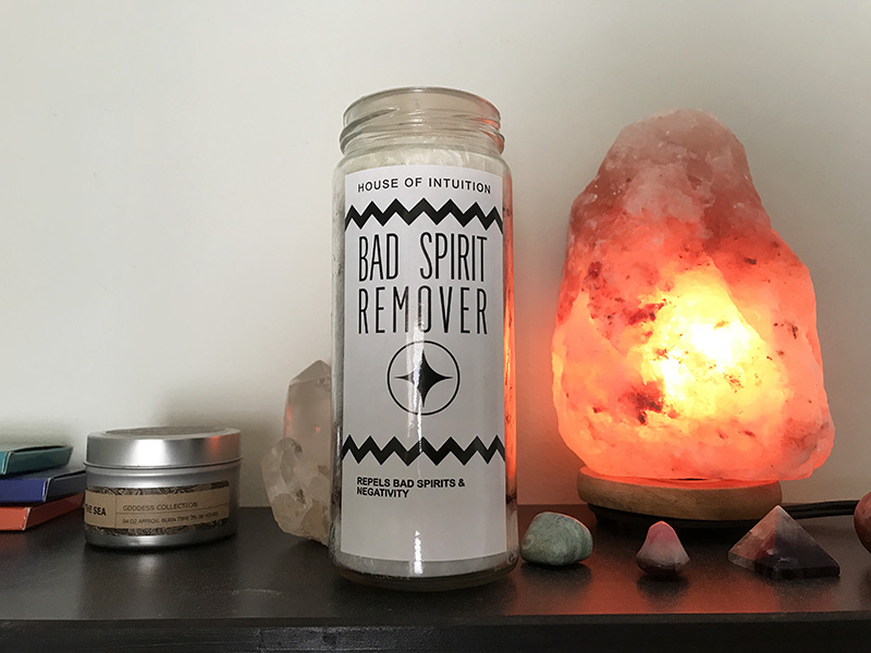 Bad Spirit Remover candle from House of Intuition on an altar next to incense and crystals