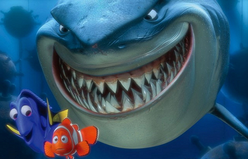 Bruce smiling behind Dory and Marlin in Disney Pixar's Finding Nemo