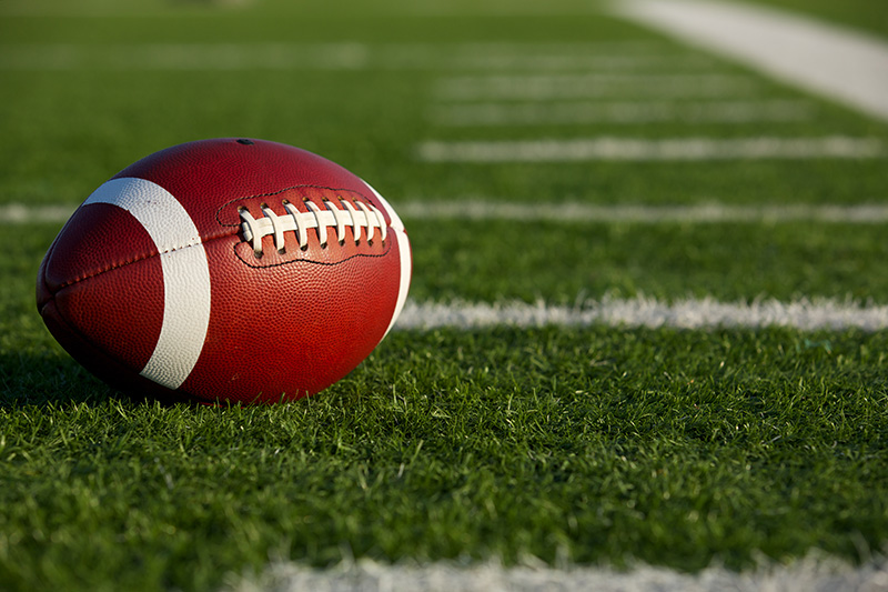 Football laying on a field