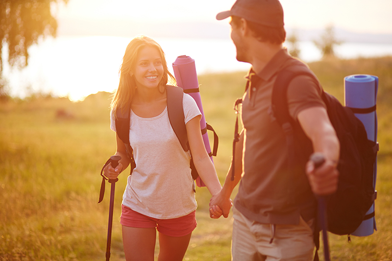 Couple going on a sunset hike