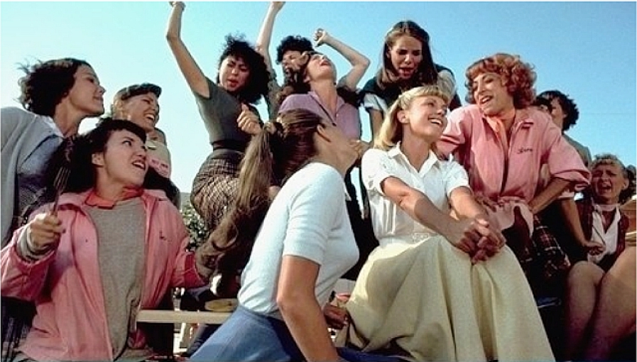 Still from Grease during Tell Me More