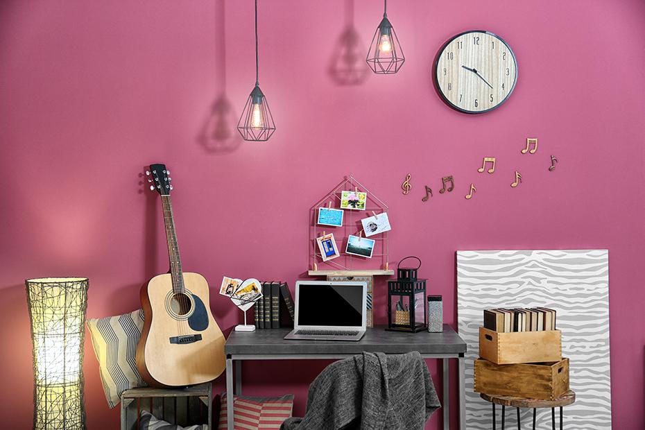 Guitar in pink bedroom