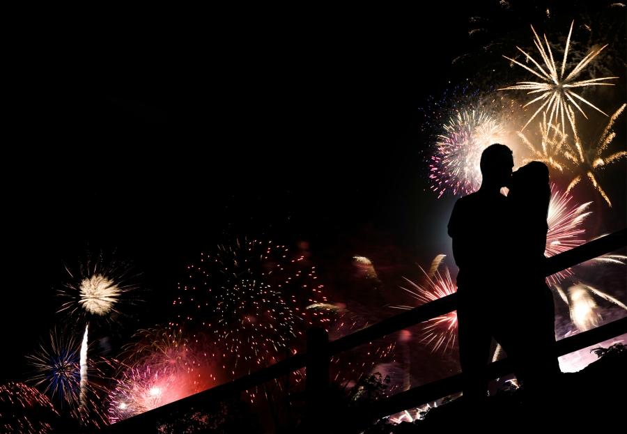Couple kissing under fireworks