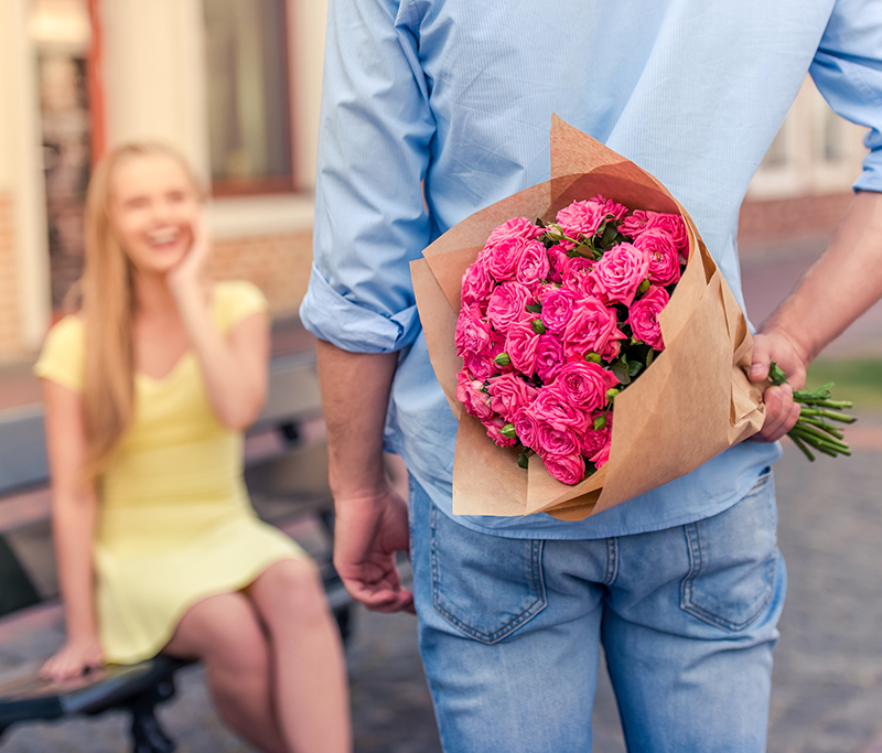 Guy brining girl flowers on their date