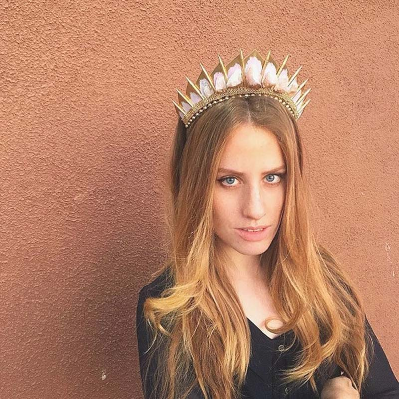 Girl wearing a rose quartz crown