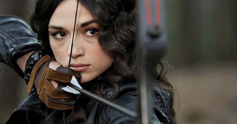 Allison Argent shooting a bow and arrow at a target on MTV's Teen Wolf