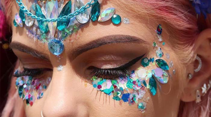 Girl wearing glitter on her face from the Gypsy Shrine