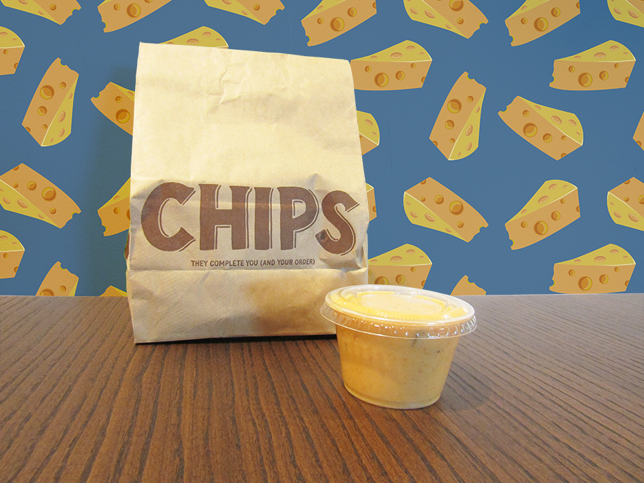 Chipotle queso in container with chips