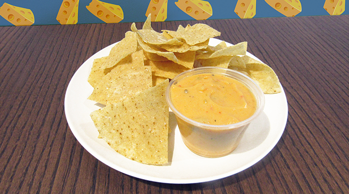 Chipotle queso and chips on plate