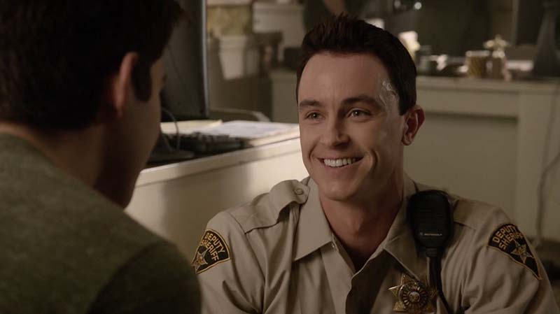 Deputy Jordan Parrish smiling at Scott McCall in an episode of MTV's Teen Wolf