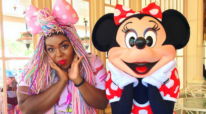 Studio Mucci's Amina Mucciolo posing with Minnie Mouse at Disneyland