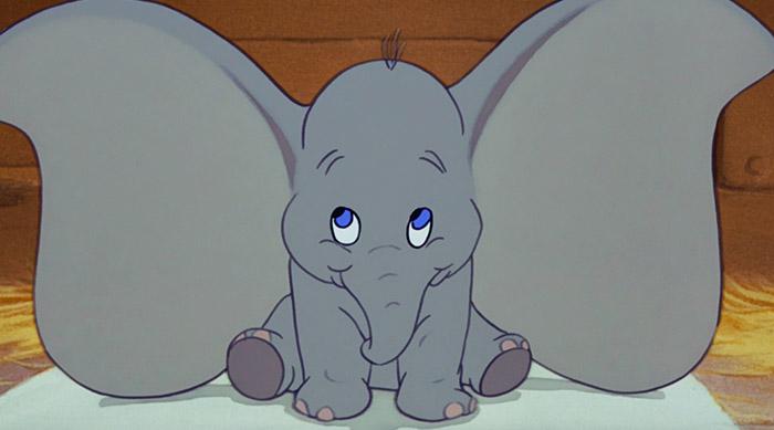 Dumbo revealing his big ears to everyone