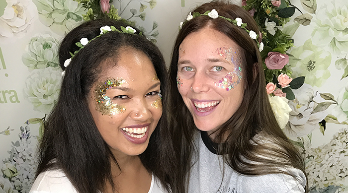 Shawna and Ashley wearing face glitter and flower crowns at Beautycon LA