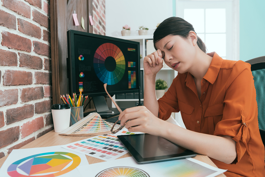 Frustrated artist woman working at desk