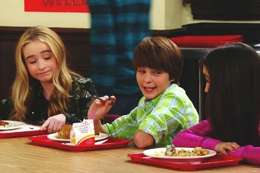 Riley and Maya talking with Farkle at lunch table