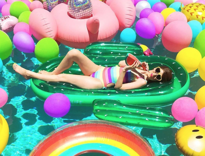 Girl with Many Colorful Floaties