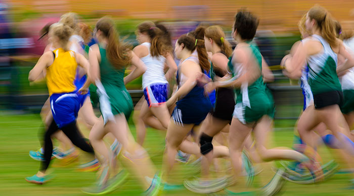 Group of girls running during gym class