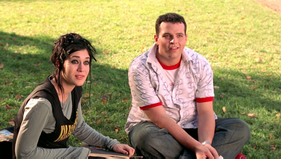 Janis and Damian sitting on grass