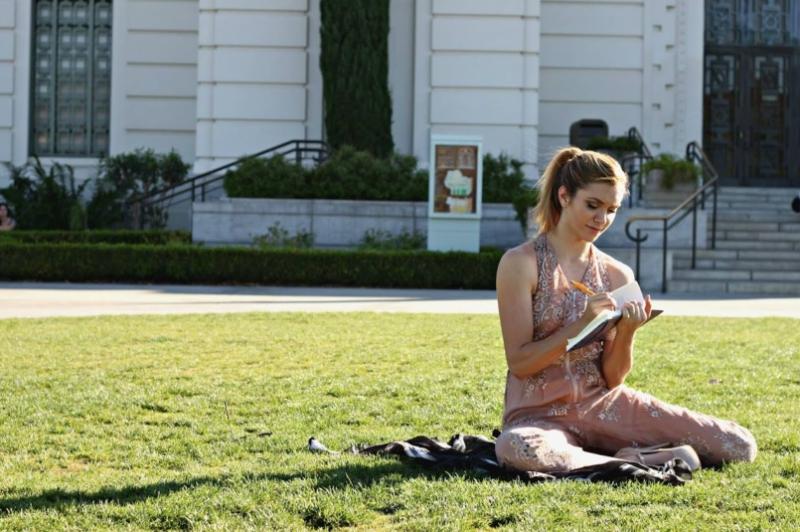 Girl Journaling on Grass