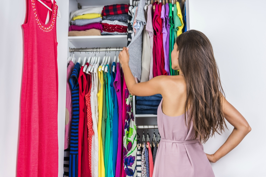 Teen picking out her clothes for first day of school