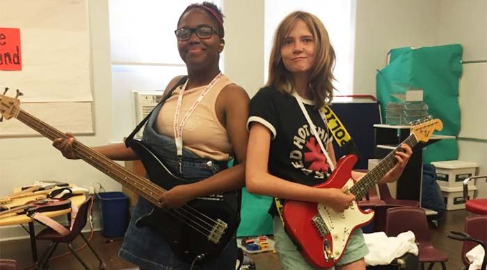 Two campers playing instruments at Rock N' Roll Camp for Girls in Los Angeles, California