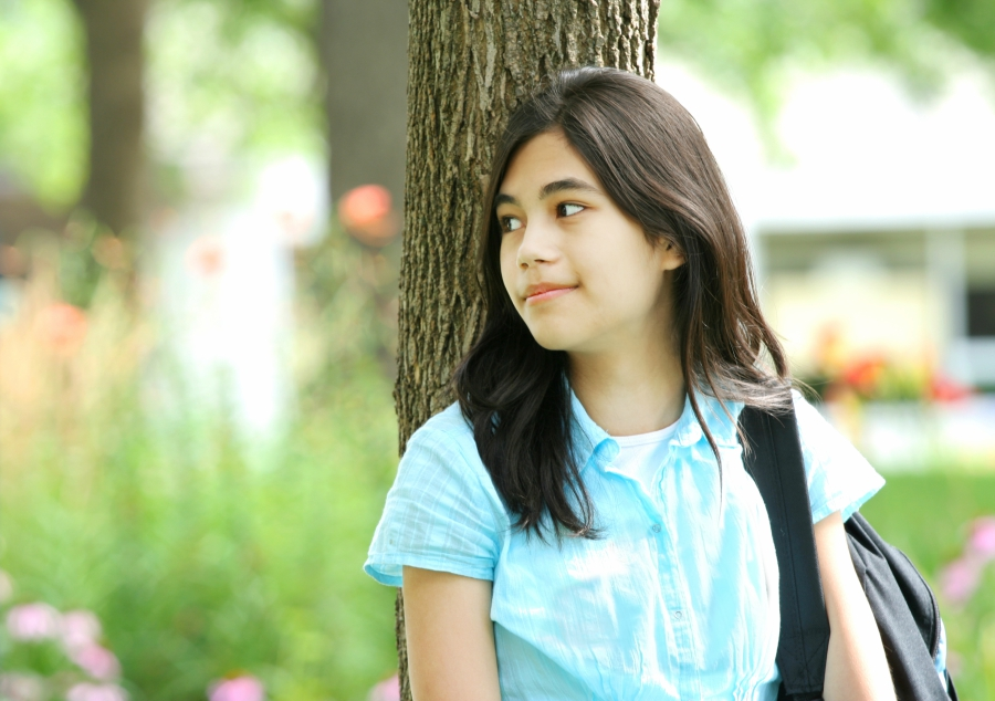 Shy teen by herself before school