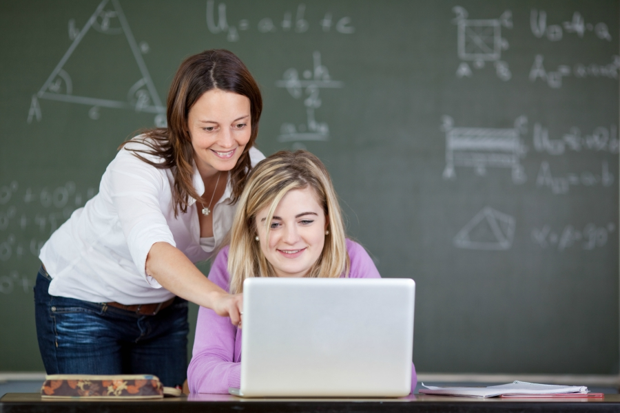 Teacher helping student with lessons