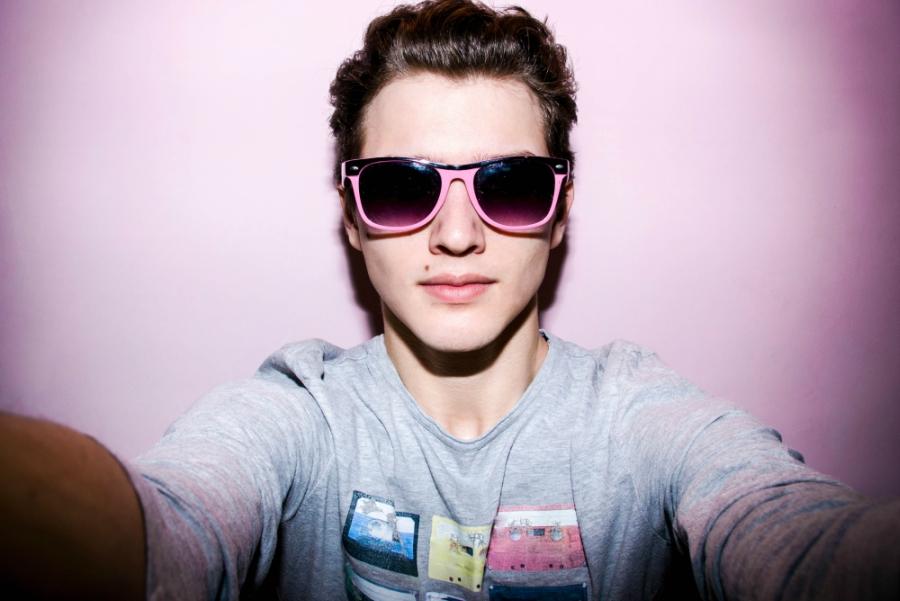 Selfie of cool guy wearing sunglasses
