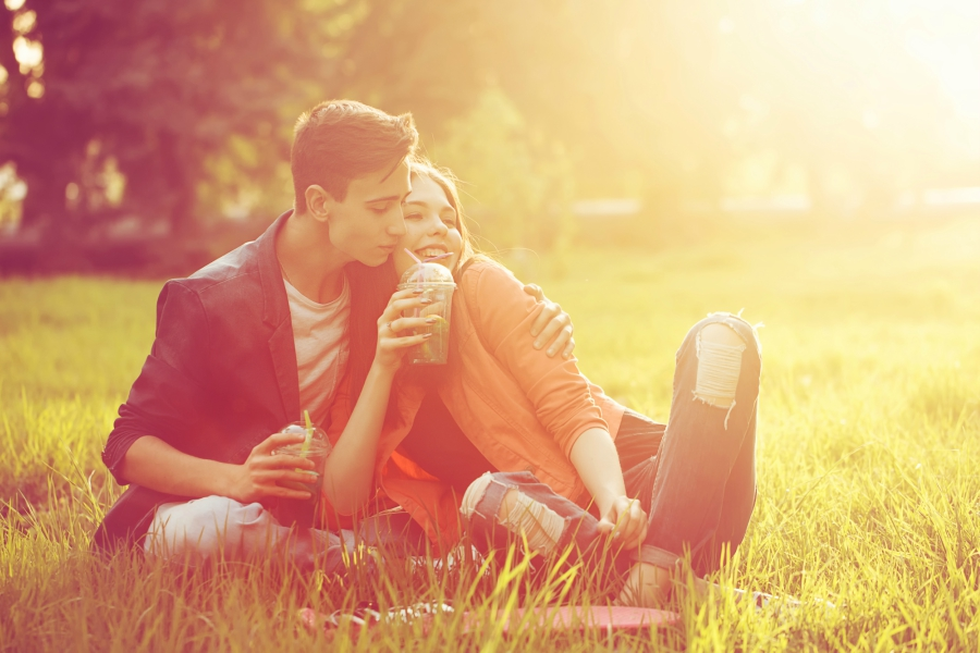 Couple in park cuddling