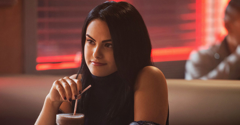 Veronica Lodge drinking a milkshake at Pop's in The CW's Riverdale
