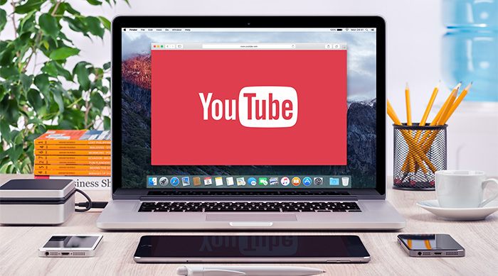 YouTube homepage on a laptop screen
