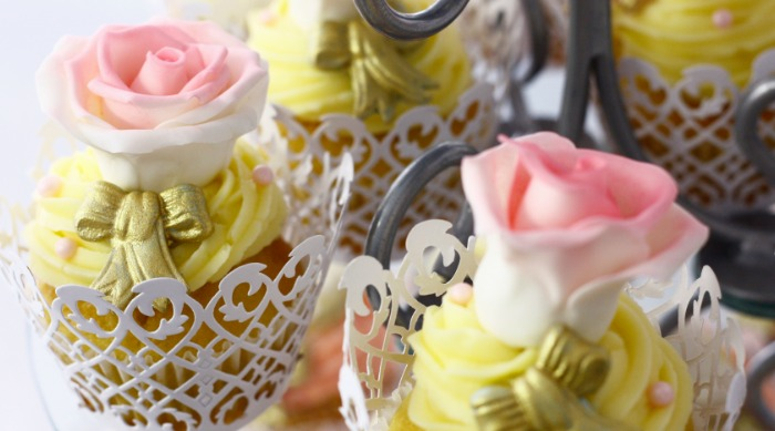 cupcakes with yellow frosting pink flowers