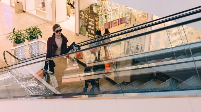 woman on escalator in mall