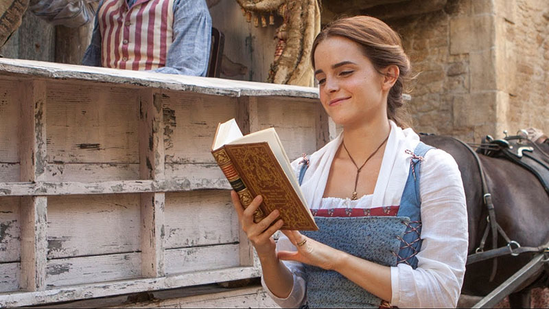 Emma Watson as Belle in Disney's live-action Beauty and the Beast reading a book