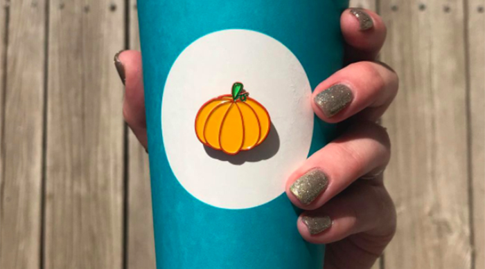 Pumpkin Spice Latte in a blue Starbucks cup