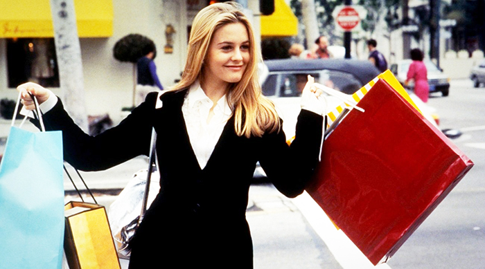 Cher holding shopping bags in Clueless