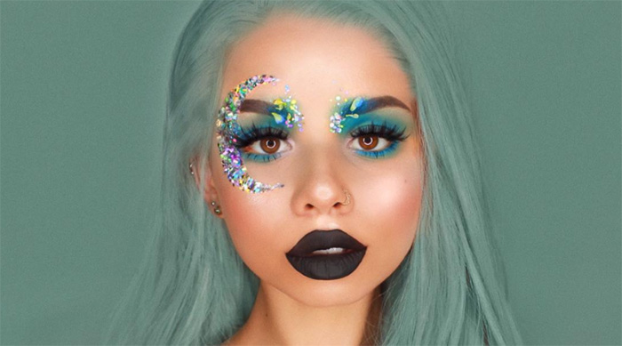 Instagram makeup artist snitchery wearing black lipstick and garden-inspired eye makeup