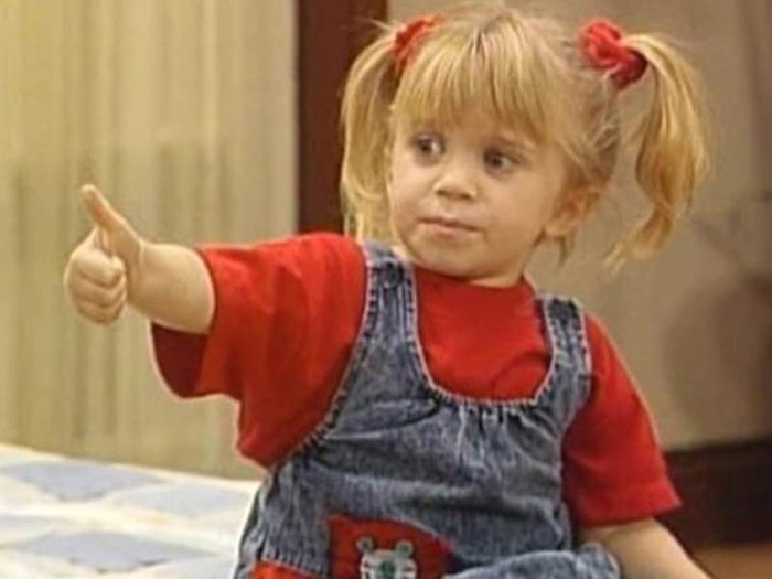 Michelle Tanner giving a thumb's up in Full House